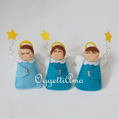 Angioletti in feltro per le bomboniere del tuo bambino (set di 20 angeli uguali per colore della tunica e tema ma diversi in volto)