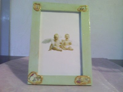 Portafoto verde pastello con decorazioni diddl