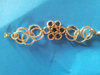 bracciale a fiore in alluminio dorato e argentato