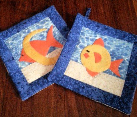 coppia di presine con pesci