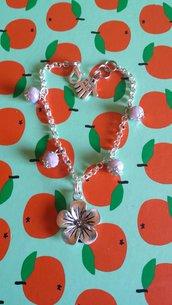 bracciale stile Hawaii con fiore e perline simil svarowsky!