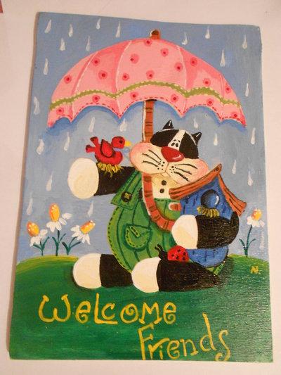 Quadretto con gatto sotto l'ombrello