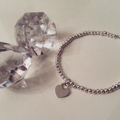 Bracciale perline in acciaio inox e ciondolo a forma di cuore