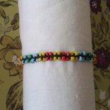 Braccialetto macramé con perline in plastica colorate