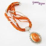 Collana con multifile di perline, filati e grande cabochon in fimo fatto a mano, tonalità arancione