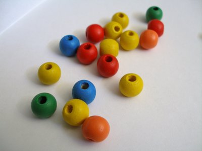 Perle di legno colorate.
