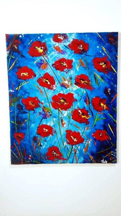 Quadro dipinto a mano raffigurante fiori rossi su sfondo blu