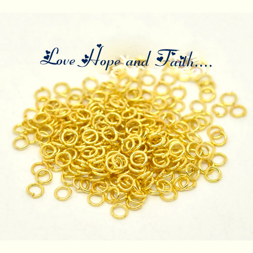 LOTTO 100 anellini aperti color oro (4x0,7mm) (cod.00558)
