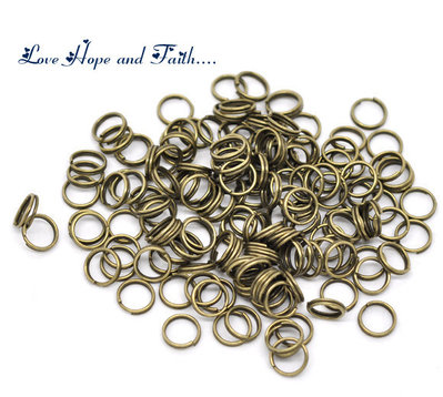 LOTTO 100 anellini aperti color bronzo (0,6x8mm) (cod.14536)