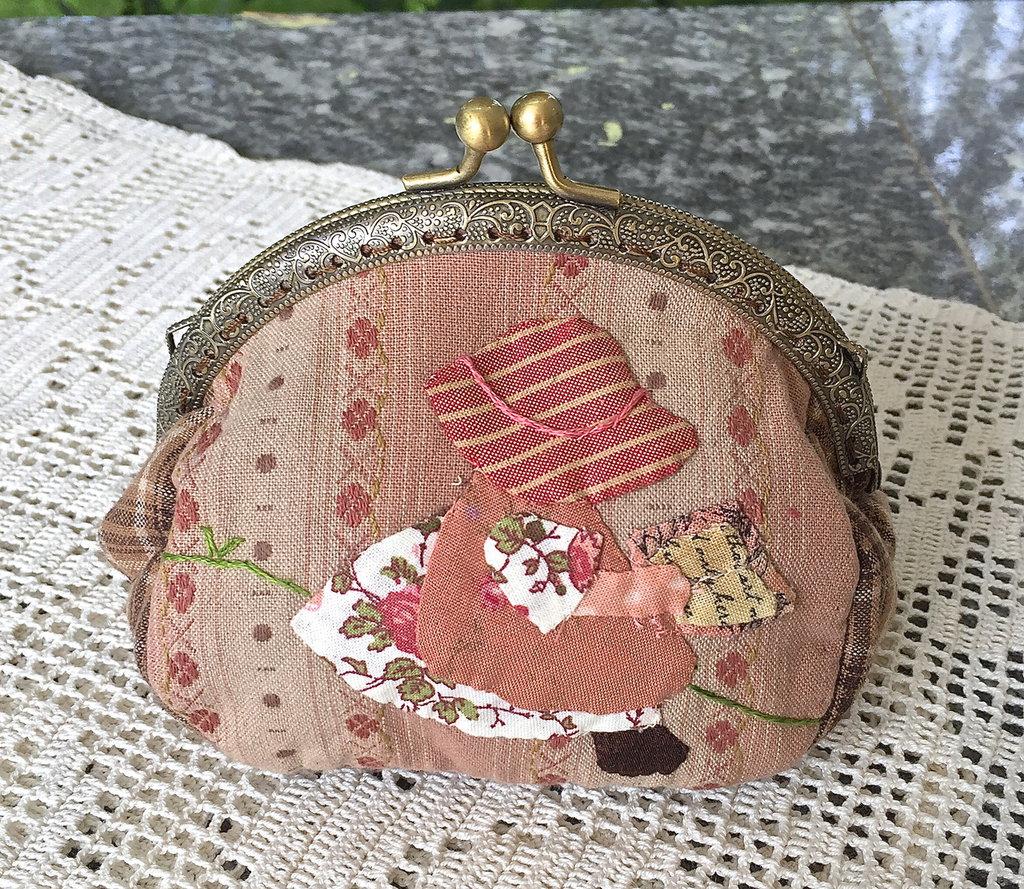 Borsellino in stoffa clic clac con Sue che legge