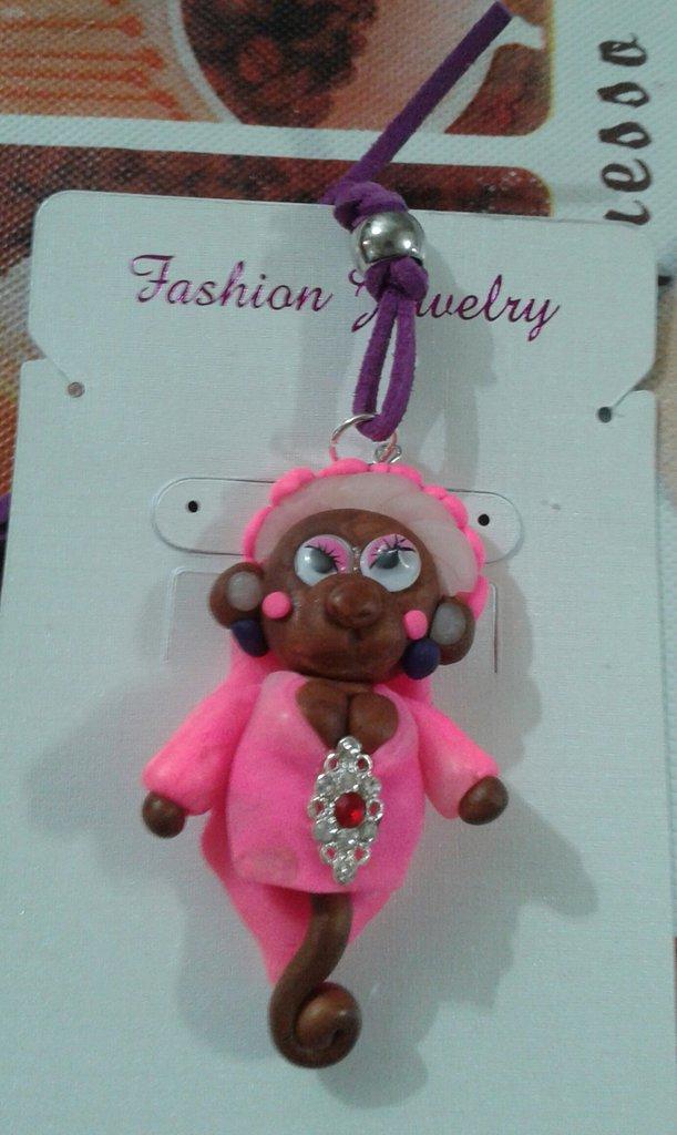 Scimmietta  sexy con vestitino rosa e brillantino