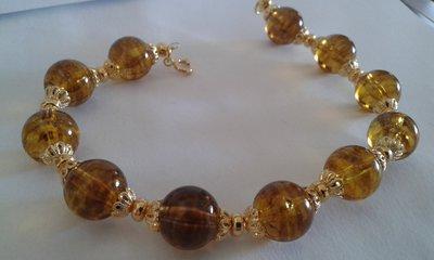 Bracciale donna di perle marroni trasparente