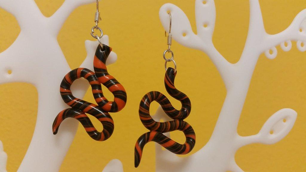 Orecchini fimo motivo spirale nero/arancione