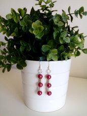 Orecchini fatti a mano con perle rosse