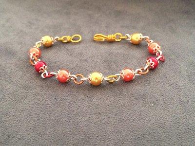 Bracciale in alluminio effetto sfumato rosso, arancio e giallo