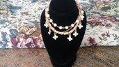 Braccialetto  con charms e perle