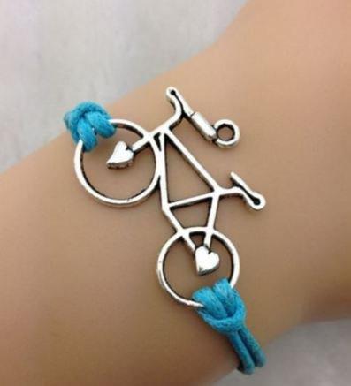 Bracciale con cordino azzurro e ciondolo bicicletta in argento tibetano idea regalo Natale per lei e lui