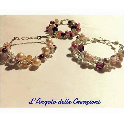 Set tre bracciali fili argento e rame, cristalli e perline di tonalità rosa
