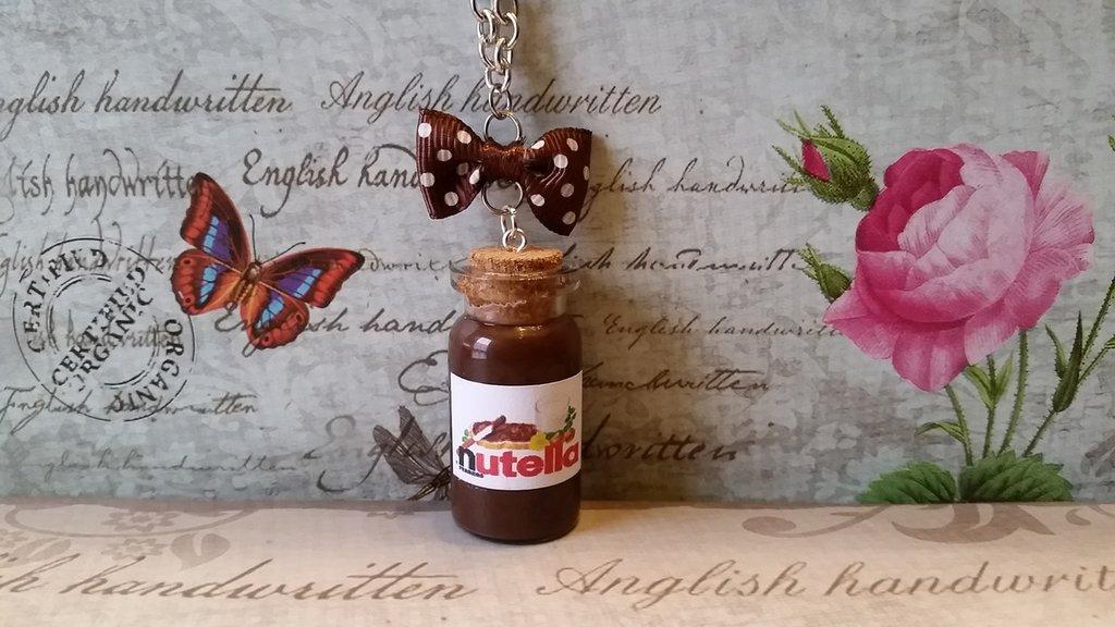 Collana boccetta di vetro con simil Nutella e fiocchetto marrone a pois