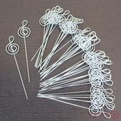 Asticelle segnaposto a forma di chiave di violino