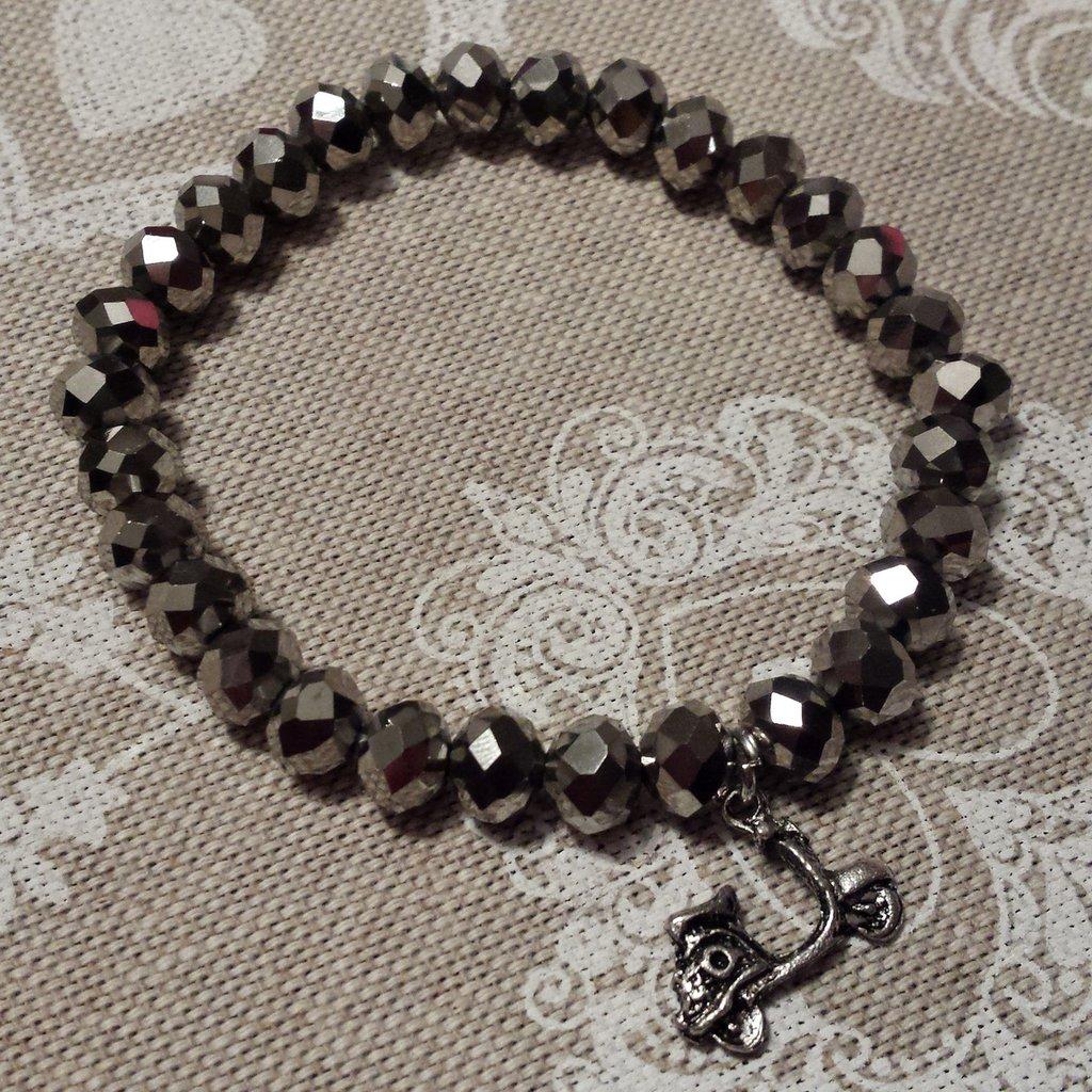 Bracciale elastico con cristalli color argento e ciondolo vespa