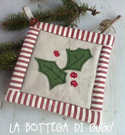 Presina natalizia con ramo di trifoglio e bordo patchwork