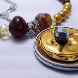 Collana oro e bronzo su cialda nespresso