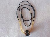 Collana lunga di perline con pendente di perline, nero e oro