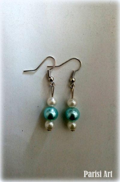 Orecchini pendenti con tris di perle