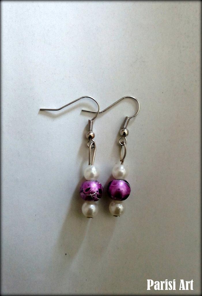 Orecchini pendenti cont ris di perle