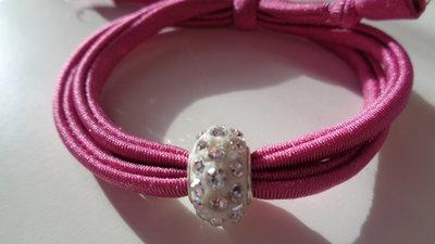 Braccialetto fettuccia elastica rosa