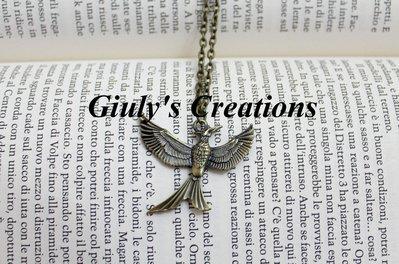 Collana con la Ghiandaia Imitatrice di Katniss Everdeen, ispirata all'ultimo capitolo della saga di Hunger Games - MockingJay, Il canto della rivolta - parte 2