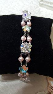 bracciale sui toni del rosa con castoni su base in argento 925, swarovski e mezzi cristalli