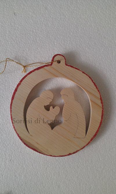 Pendel in legno, immagine della Sacra Famiglia nel tondo