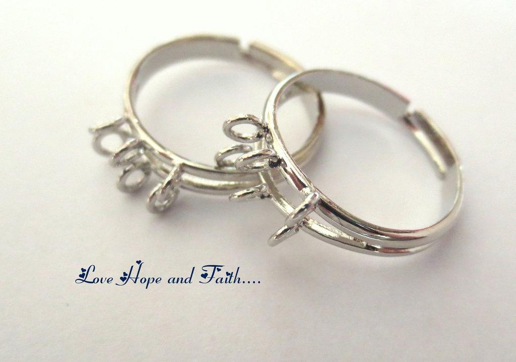 Base anello color argento con occhielli (17.1mm) (cod.26054)