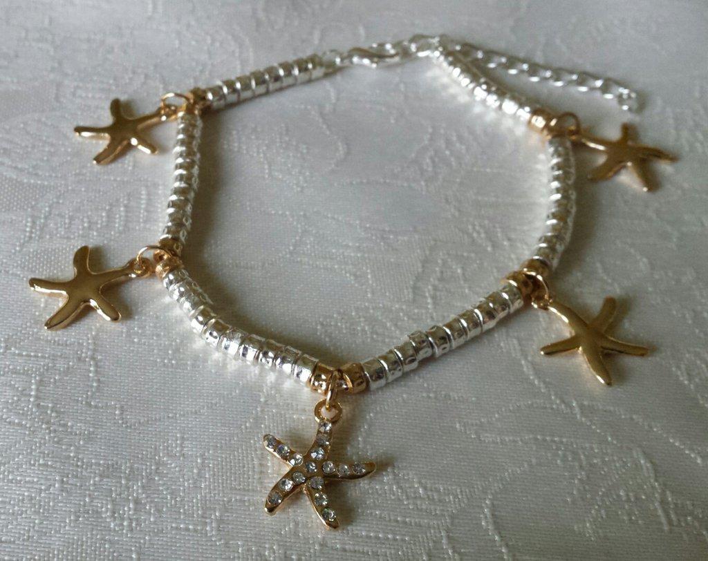 Bracciale in metallo color argento con ciondoli stelle marine