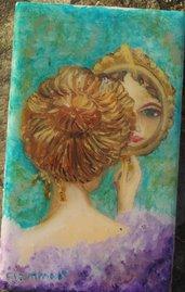 Quadro di donna allo specchio. 'Specchio, specchio delle mie brame.......'