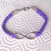Braccialetto con cordoncino lilla intrecciato a mano e simbolo dell'infinito, con chiusura a moschettone regolabile