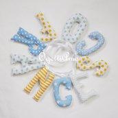 FRANCESCO: una ghirlanda di lettere imbottite gialle e azzurre per decorare la sua cameretta
