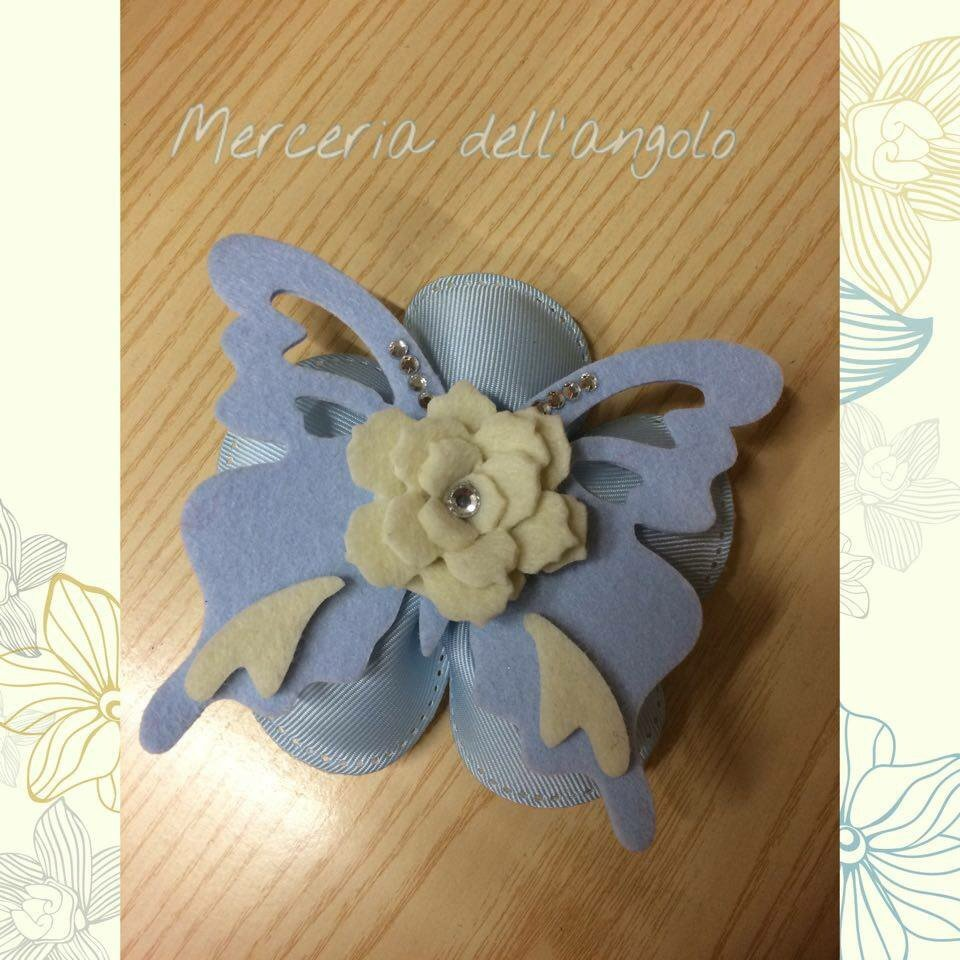 Bomboniera bimbo fiore e farfalla