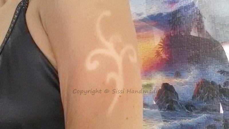 Tatuaggio con il sole swirly solar tattoo