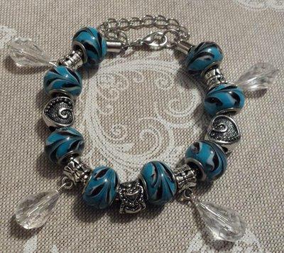 Bracciale metallo perle foro largo in azzurro