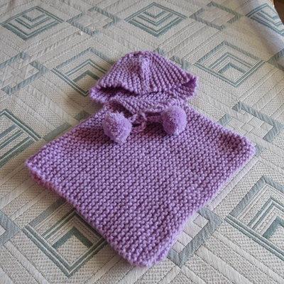 poncho color glicine con cappuccio per bimba