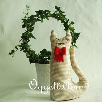 Un attino con papillon come fermaporta: gatti, gufi e civette per decorare casa!