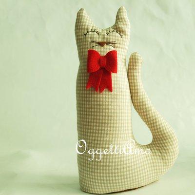 Un gattino con papillon come fermaporta: gatti, gufi e civette per decorare casa!