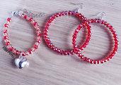 Parure Bracciale con cristalli alternati color rosso e rosa con charm cuore e orecchini con cristalli color rosso. Una parure total Red Passion