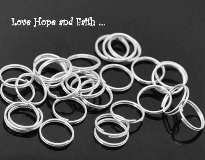 LOTTO 50 anellini doppio giro aperti color argento chiaro (12mm) (cod.04159)