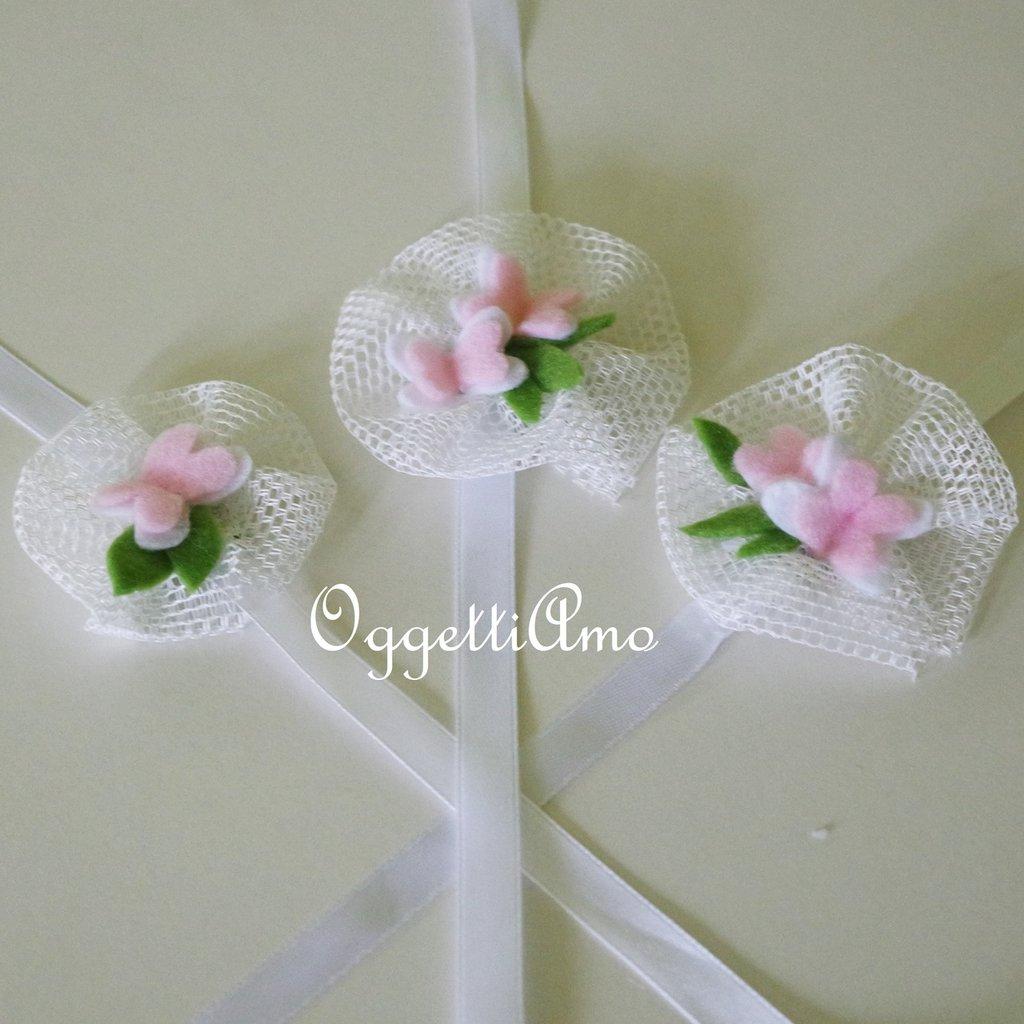 Coccarde di tulle, farfalle e fiori in feltro come segnaposto o per bomboniere delicatamente eleganti ed originali!