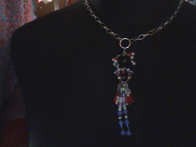 Collana con bambolina pietre dure, swarovsky e cristalli.