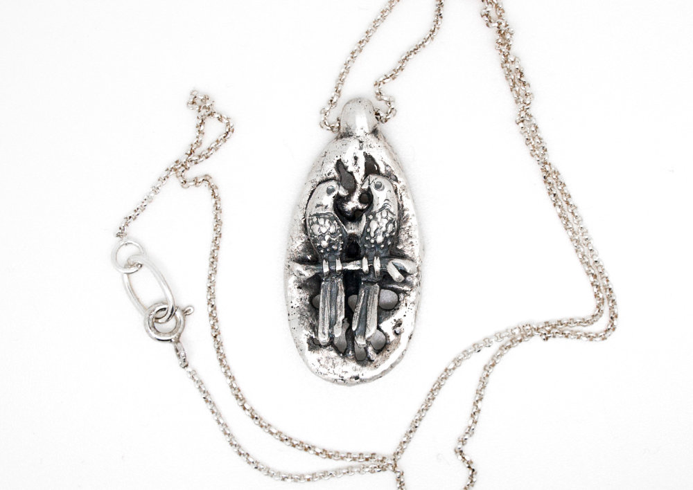 Pendente con pappagalli in puro argento e catena in argento